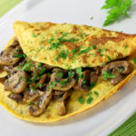 Receta de tortilla con revuelto de champiñones